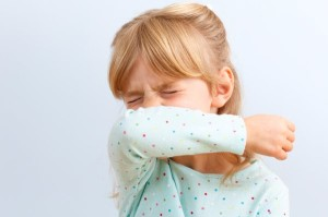 girl-sneezing-into-elbow